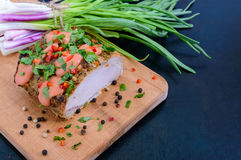 Large piece pork baked ham, with green onions and sauce on the cutting board Stock Photo
