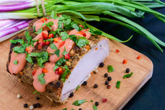 Large piece pork baked ham, with green onions and sauce on the cutting board Stock Photos