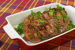 A large piece of veal pork cooked in the oven. With a ceramic baking Royalty Free Stock Photography