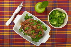 A large piece of veal pork cooked in the oven. With a ceramic baking Stock Images