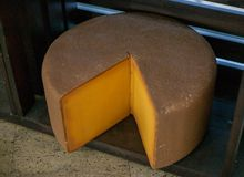 A large piece of yellow cheese royalty free stock image