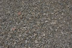 Large pieces rough edged construction gravel. Large pieces of rough edged construction gravel with different sizes and color of the gravel, with a few pieces of Stock Image