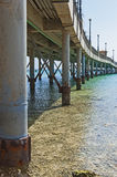 Large pier jetty on a tropical beach resort Stock Photos