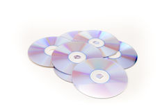 Large pile of fresh CDs and DVD. Large pile of blue CDs and DVD isolated against a white background Royalty Free Stock Image