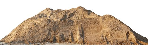 A large pile of construction sand with traces of tractor wheels. Isolated on white outdoor shot royalty free stock photo