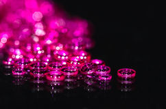 Large Pile of Hole Jewels Gathered on a Black Surface Royalty Free Stock Photos