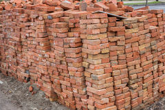 Large pile of red bricks Stock Images