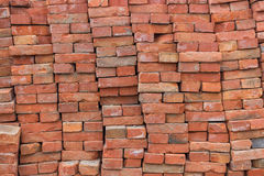 Large pile of red bricks background Stock Photo