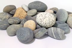 A large pile of smooth textured sea rocks. Stock Photography