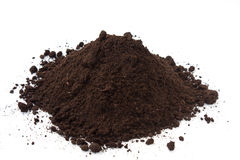 Large pile of soil on the white background Stock Images