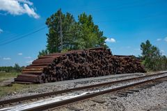 A large pile of unused and discarded railroad tiles. stock photo