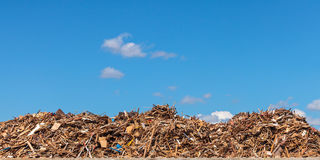 Large pile of wood on a garbage depot Royalty Free Stock Photos