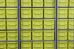 Large pile of yellow plastic boxes Royalty Free Stock Photography