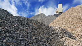 Large piles of limestone for use in lime kiln line with blue sky and cloud. Limestone gravel background Texture stock images