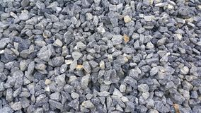 Large piles of limestone for use in lime kiln line. Limestone gravel background Texture royalty free stock photos