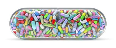 Large pill filled with colorful pills stock photo