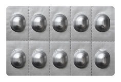 Large pills in silver foil blister wrap Royalty Free Stock Images