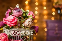 Large pink peonies on a background of lights. Vintage Royalty Free Stock Image