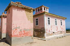 Large pink ruined mansion from Portuguese colonial times in Angola. Large pink ruined mansion from Portuguese colonial times in small coastal village of Angola`s Royalty Free Stock Photography