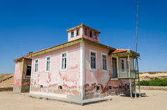 Large pink ruined mansion from Portuguese colonial times in Angola. Large pink ruined mansion from Portuguese colonial times in small coastal village of Angola`s Stock Photography