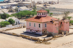 Large pink ruined mansion from Portuguese colonial times in Angola. Large pink ruined mansion from Portuguese colonial times in small coastal village of Angola`s Stock Images