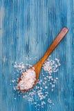 Large pink sea salt on blue background Stock Photo