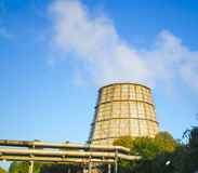 Large pipe plant with smoke on a sunny day Stock Image