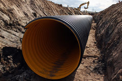 Large pipe in trench Stock Photography