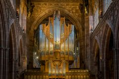 The pipes of a pipe organ in a cathedral. stock images