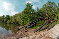 Large pipes running into the lake Royalty Free Stock Photos
