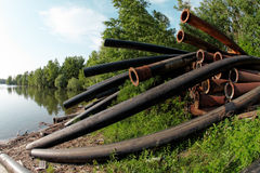 Large pipes running into the lake Royalty Free Stock Photo