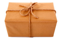 Large plain brown paper parcel or package tied with thick rope isolated Stock Photography