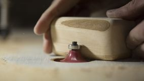 A large plan, hands of an artisan working on a wooden part.  Royalty Free Stock Photos