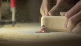 A large plan, hands of an artisan working on a wooden part.  Royalty Free Stock Images