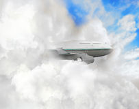 Large plane in clouds Stock Photos
