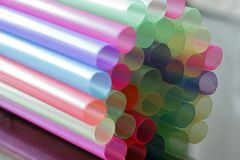 Large Plastic pastel colored drinking straws, close up stock images