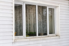 Large plastic window on the wall of siding Royalty Free Stock Images