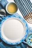 Large plate and olive oil in a bowl, Hanukkah on a table Stock Images