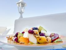 A large plate with pieces of fresh fruit royalty free stock photos