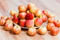 A large plate of red apples stock photos