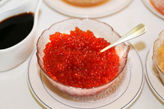 Large plate with red caviar Stock Photo