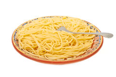 A large plate of spaghetti with a fork Royalty Free Stock Photo