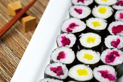 Large plated filled with Pickled Hand Rolled Sushi Stock Photo