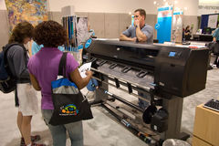 Large plotter, ESRI conference. SAN DIEGO, JUNE 18: Hewlett Packard (HP) large plotter at the ESRI international user conference which is held annually and is stock images