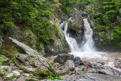 Bash Bish Falls with a large pointed rock. A large pointed rock sits close to Bash Bish Falls in Mount Washington, Massachusetts stock photo