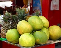 Large Pomelos and Pineapples Stock Photography
