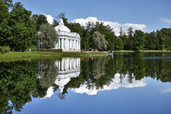 A large pond in the Catherine Palace. Pure reflection, a tea house on the lake in the Catherine Palace in St. Petersburg Royalty Free Stock Photo