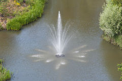 Large pond with fountain Royalty Free Stock Photography