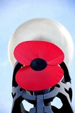 Large poppy on streetlight, Birmingham. Royalty Free Stock Photo