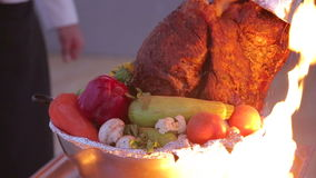 Large pork leg pechenitsa in the fire with vegetables stock video footage